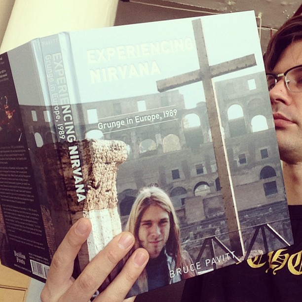 Magnus judging the cover of EXPERIENCING NIRVANA by Bruce Pavitt